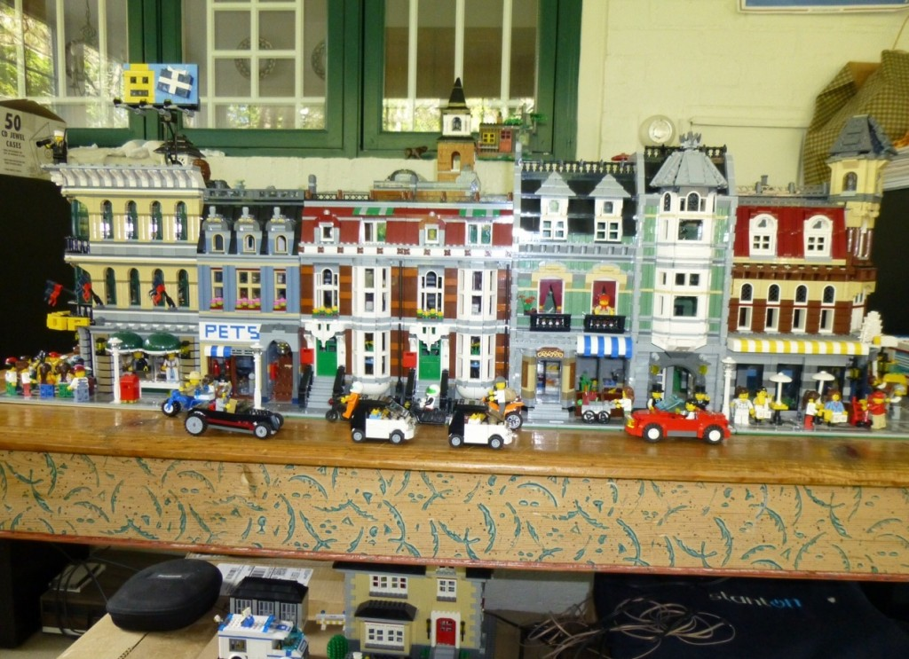 The main street of Little Brick Town, along with a glimpse of its dystopian underworld