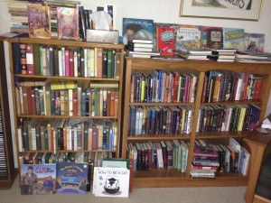 Bookcases with winners of the Newbery and Printz medals, with autographed copies of other books on top.