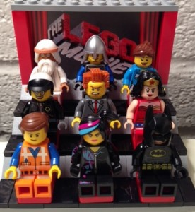 LEGO Movie characters, from a collector can sent by the studio, settle in for a screening. Lord Business is not happy that is view is blocked by Wyldstyle's hair.