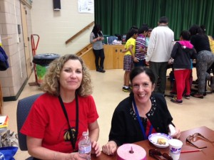 Teachers Colleen Kubinski (left) and Anne Gardiner at the Multicultural Dinner.