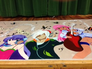 The middle section of the mural-in-progress, displayed at the Multicultural Dinner.