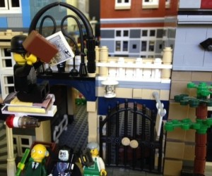 """Lego Fernando Pessoa escapes his captors on a volume of Pablo Neruda's poems, shouting, """"Books can take you anywheeerrre..."""""""