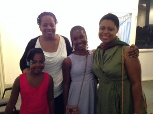 Ibi Zoboi celebrates her graduation with her daughters and former advisor Coe Booth.