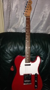 This is the guitar I salvaged from my basement, a survivor of Hurricane Irene. One day, I'm going to learn to play it.