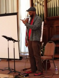 The versatile, talented, and generally lovely Shane L. Evans performs with music, illustrations, and word play.