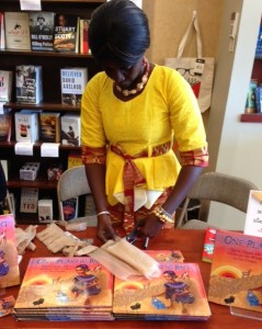 Isatou Ceesay demonstrates how she cuts the plastic bag to make one continuous strand, first folding the bag and making straight cuts, leaving about an inch uncut at the end.