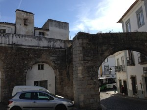 The ancient Roman aqueduct cuts through the center of Evora.