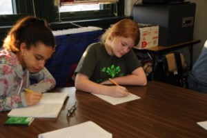Students at New Voices School work on their revisions. Photo by Susan Korchak.