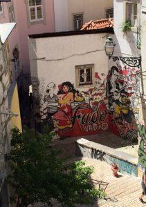 A mural recalls Mouraria's past as a center of fado.