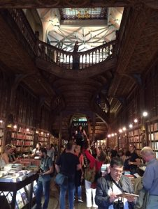 A crowded Livraria Lello, inspiration for Hogwarts in the Harry Potter series.