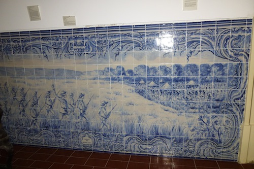 This azulejo at the Military Museum in Lisbon depicts the Portuguese invasion of an African village, with the European faces detailed and the Africans a blur. Another case where evil won.
